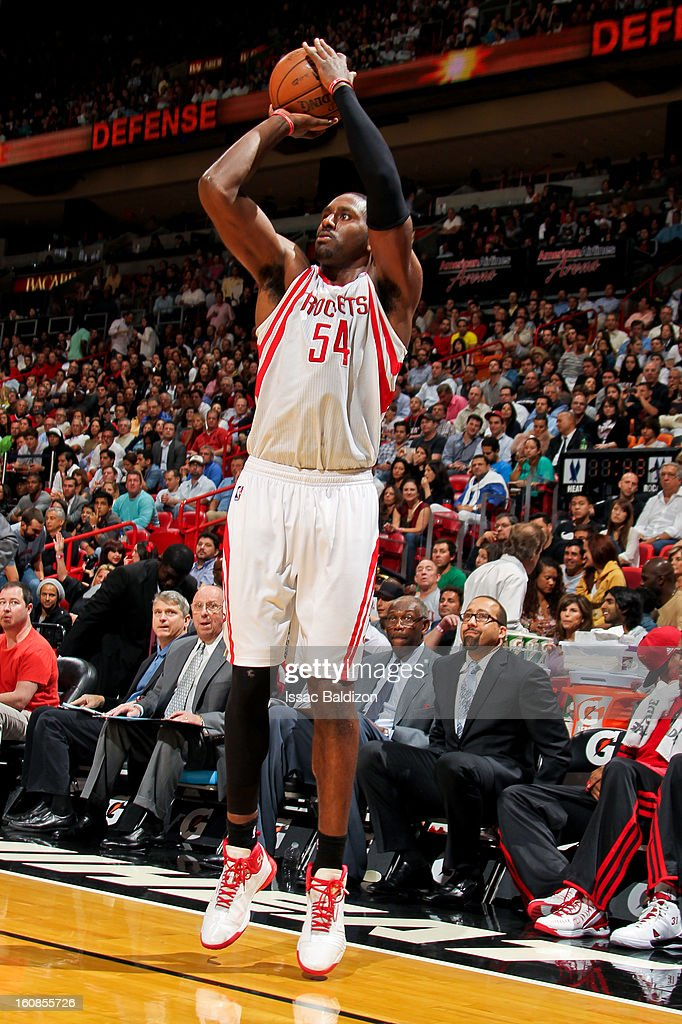 Patrick Patterson #54 of the Houston Rockets shoots a three-pointer against the Miami Heat on February 6, 2013 at American Airlines Arena in Miami, Florida.