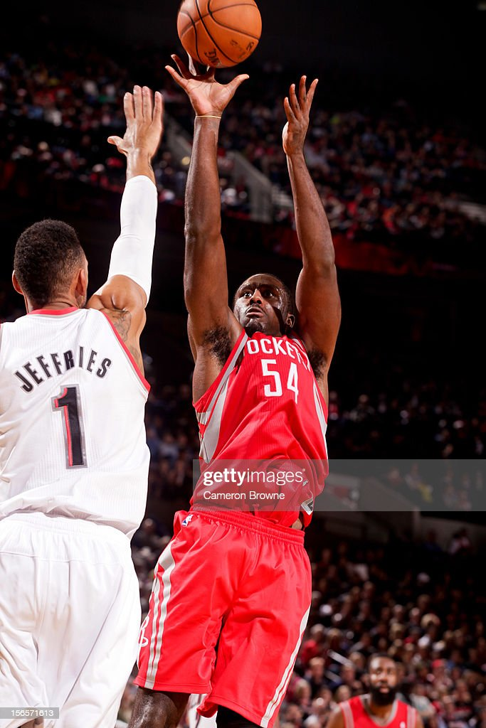 <a gi-track='captionPersonalityLinkClicked' href=/galleries/search?phrase=Patrick+Patterson&family=editorial&specificpeople=2928099 ng-click='$event.stopPropagation()'>Patrick Patterson</a> #54 of the Houston Rockets shoots against <a gi-track='captionPersonalityLinkClicked' href=/galleries/search?phrase=Jared+Jeffries&family=editorial&specificpeople=202548 ng-click='$event.stopPropagation()'>Jared Jeffries</a> #1 of the Portland Trail Blazers on November 16, 2012 at the Rose Garden Arena in Portland, Oregon.