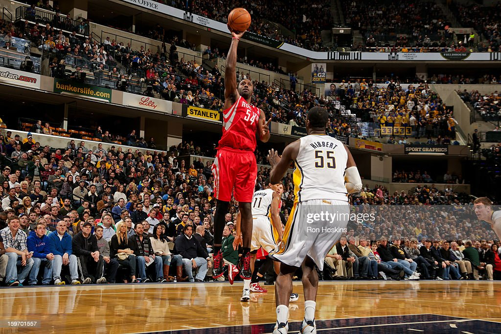 Patrick Patterson #54 of the Houston Rockets shoots against Roy Hibbert #55 of the Indiana Pacers of the Indiana Pacers of the Houston Rockets on January 18, 2013 at Bankers Life Fieldhouse in Indianapolis, Indiana.