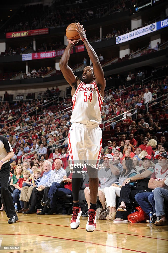 <a gi-track='captionPersonalityLinkClicked' href=/galleries/search?phrase=Patrick+Patterson&family=editorial&specificpeople=2928099 ng-click='$event.stopPropagation()'>Patrick Patterson</a> #54 of the Houston Rockets shoots against the Dallas Mavericks on December 8, 2012 at the Toyota Center in Houston, Texas.