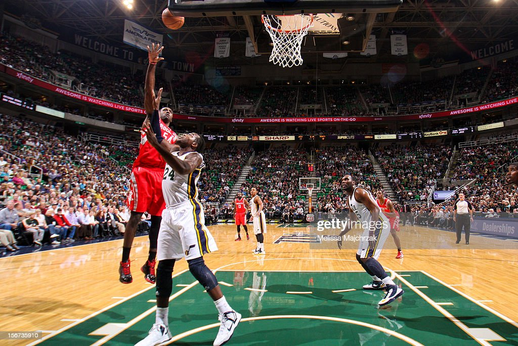 Patrick Patterson #54 of the Houston Rockets shoots in the lane against Paul Millsap #24 of the Utah Jazz at Energy Solutions Arena on November 19, 2012 in Salt Lake City, Utah.