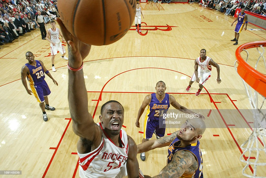 Patrick Patterson #54 of the Houston Rockets shoots the ball against Robert Sacre #50 of the Los Angeles Lakers on January 8, 2013 at the Toyota Center in Houston, Texas.