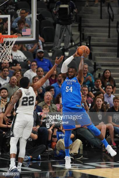 Patrick Patterson of the Oklahoma City Thunder gets the rebound against the San Antonio Spurs on November 17 2017 at the ATT Center in San Antonio...