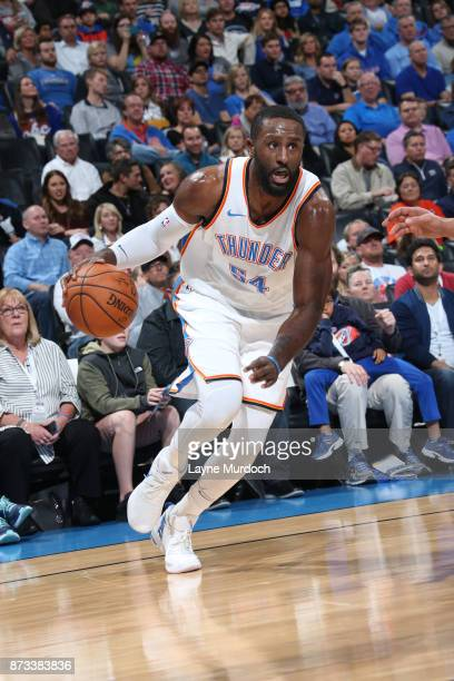 Patrick Patterson of the Oklahoma City Thunder handles the ball against the Dallas Mavericks on November 12 2017 at Chesapeake Energy Arena in...