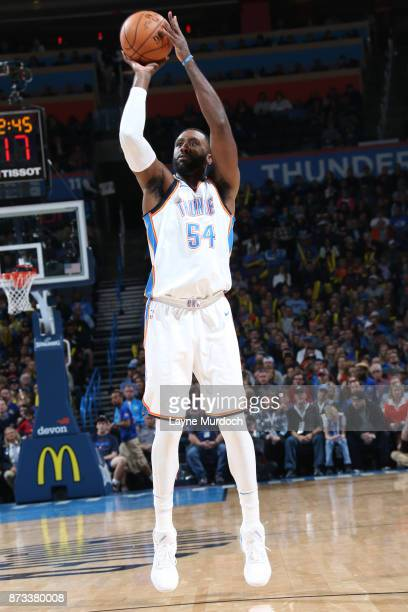 Patrick Patterson of the Oklahoma City Thunder shoots the ball against the Dallas Mavericks on November 12 2017 at Chesapeake Energy Arena in...
