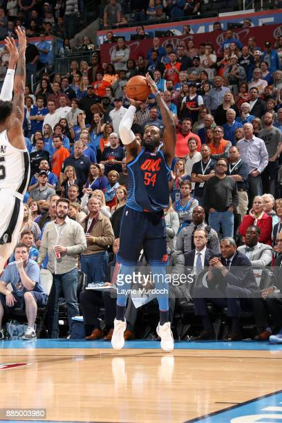 Patrick Patterson of the Oklahoma City Thunder shoots the ball against the San Antonio Spurs on December 3 2017 at Chesapeake Energy Arena in...