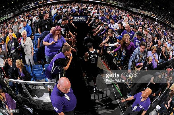 Patrick Patterson of the Sacramento Kings greets fans while heading into the tunnel in a game against the Los Angeles Clippers on April 17 2013 at...
