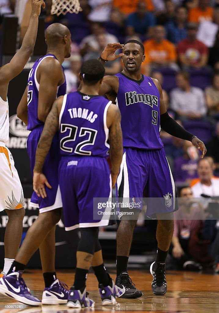 Patrick Patterson #9 of the Sacramento Kings high fives teammates after scoring and drawing a foul against the Phoenix Suns during the second half of the NBA game at US Airways Center on November 20, 2013 in Phoenix, Arizona. The Kings defeated the Suns 113-106.