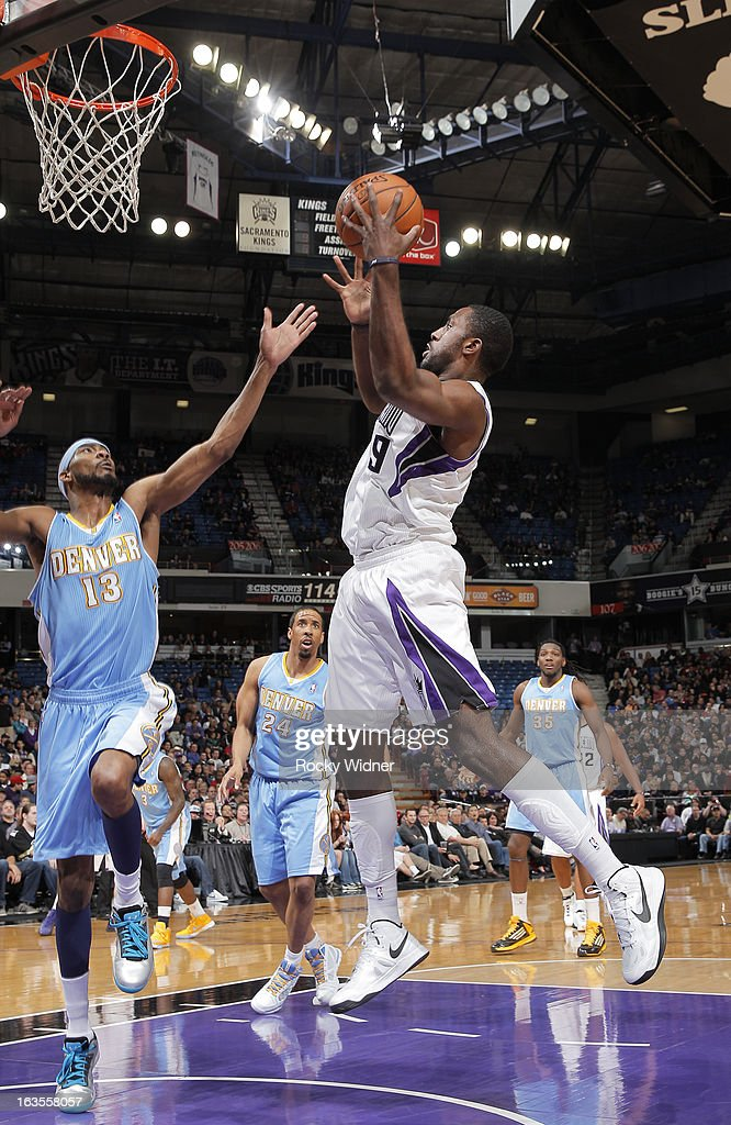 Patrick Patterson #9 of the Sacramento Kings rebounds against Corey Brewer #13 of the Denver Nuggets on March 5, 2013 at Sleep Train Arena in Sacramento, California.