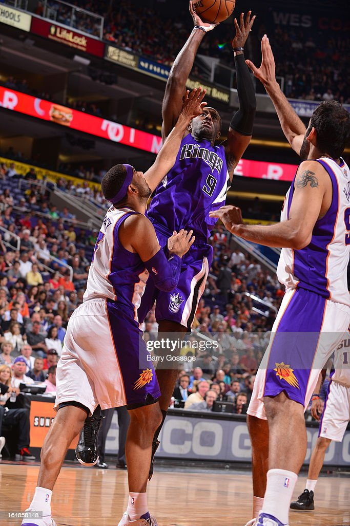 <a gi-track='captionPersonalityLinkClicked' href=/galleries/search?phrase=Patrick+Patterson&family=editorial&specificpeople=2928099 ng-click='$event.stopPropagation()'>Patrick Patterson</a> #9 of the Sacramento Kings shoots against <a gi-track='captionPersonalityLinkClicked' href=/galleries/search?phrase=Jared+Dudley&family=editorial&specificpeople=224071 ng-click='$event.stopPropagation()'>Jared Dudley</a> #3 and <a gi-track='captionPersonalityLinkClicked' href=/galleries/search?phrase=Hamed+Haddadi&family=editorial&specificpeople=5544688 ng-click='$event.stopPropagation()'>Hamed Haddadi</a> #98 of the Phoenix Suns on March 28, 2013 at U.S. Airways Center in Phoenix, Arizona.