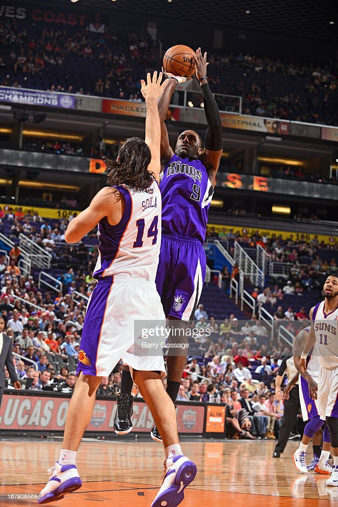 <a gi-track='captionPersonalityLinkClicked' href=/galleries/search?phrase=Patrick+Patterson&family=editorial&specificpeople=2928099 ng-click='$event.stopPropagation()'>Patrick Patterson</a> #9 of the Sacramento Kings shoots the ball against the Phoenix Suns on March 28, 2013 at U.S. Airways Center in Phoenix, Arizona.