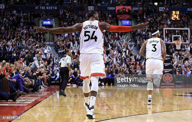 Patrick Patterson of the Toronto Raptors celebrates a threepointer during the second half of an NBA game against the Oklahoma City Thunder at the Air...