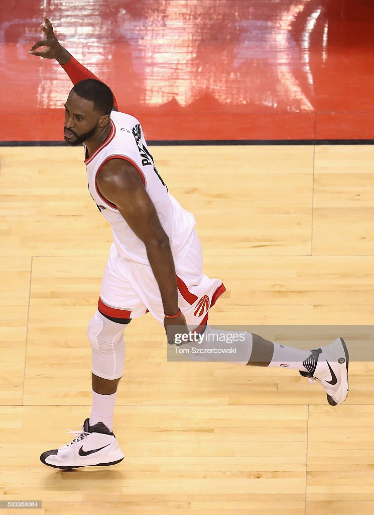 Patrick Patterson #54 of the Toronto Raptors celebrates after making a three point basket during the second half against the Cleveland Cavaliers in game three of the Eastern Conference Finals during the 2016 NBA Playoffs at Air Canada Centre on May 21, 2016 in Toronto, Canada.