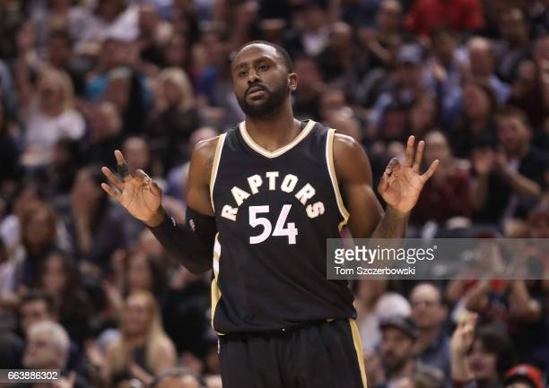 Patrick Patterson of the Toronto Raptors celebrates as he makes a threepoint shot against the Philadelphia 76ers during NBA game action at Air Canada...