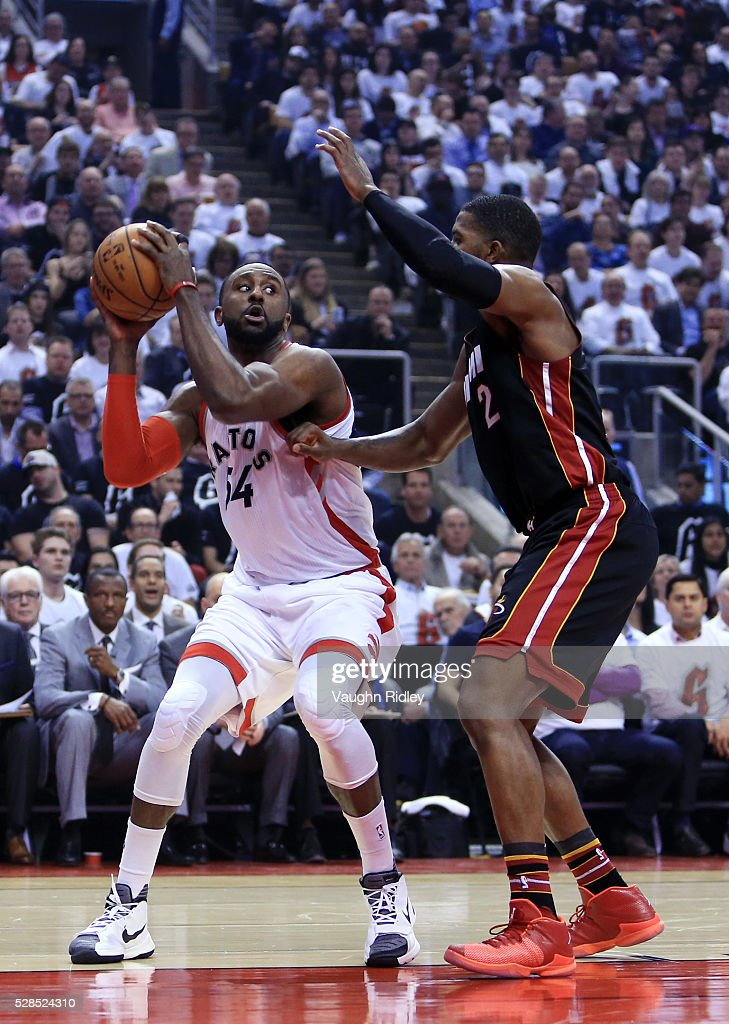 <a gi-track='captionPersonalityLinkClicked' href=/galleries/search?phrase=Patrick+Patterson&family=editorial&specificpeople=2928099 ng-click='$event.stopPropagation()'>Patrick Patterson</a> #54 of the Toronto Raptors dribbles the ball as <a gi-track='captionPersonalityLinkClicked' href=/galleries/search?phrase=Joe+Johnson+-+Basketball+Player&family=editorial&specificpeople=201652 ng-click='$event.stopPropagation()'>Joe Johnson</a> #2 of the Miami Heat defends in the first half of Game Two of the Eastern Conference Semifinals during the 2016 NBA Playoffs at the Air Canada Centre on May 5, 2016 in Toronto, Ontario, Canada.