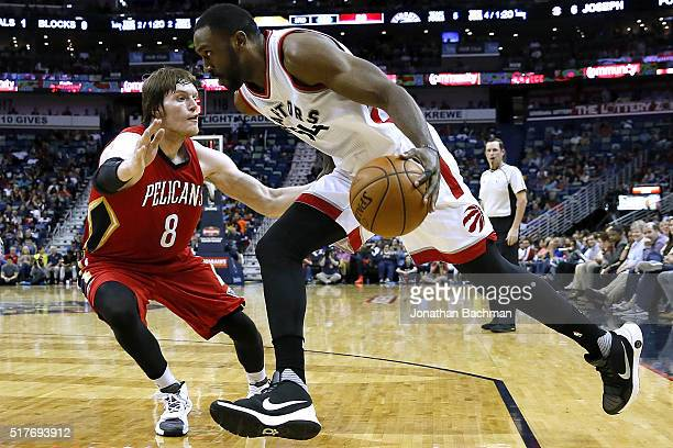 Patrick Patterson of the Toronto Raptors drives against Luke Babbitt of the New Orleans Pelicans during the second half of a game at the Smoothie...