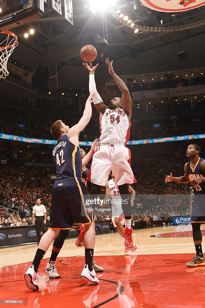 Patrick Patterson #54 of the Toronto Raptors goes for the layup against Shayne Whittington #42 of the Indiana Pacers during the game on December 12, 2014 at Air Canada Centre in Toronto, Ontario.