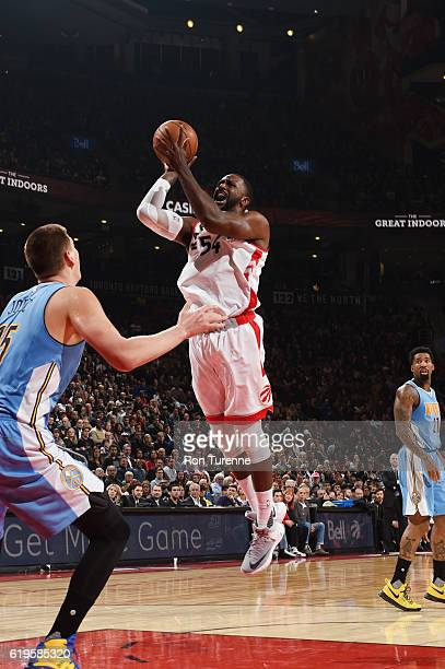 Patrick Patterson of the Toronto Raptors goes up for a shot during a game against the Denver Nuggets on October 31 2016 at the Air Canada Centre in...