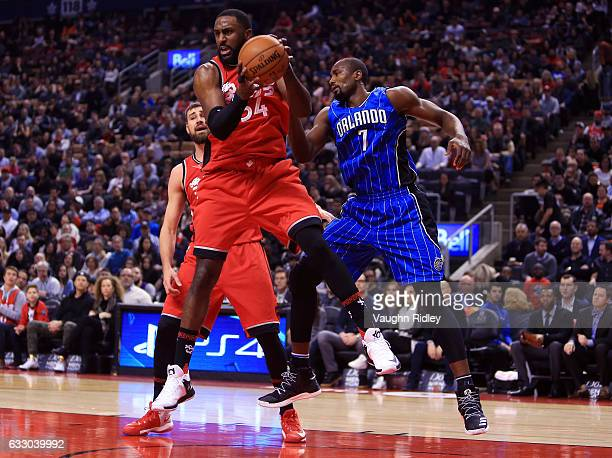 Patrick Patterson of the Toronto Raptors grabs a rebound as Serge Ibaka of the Orlando Magic defends during the first half of an NBA game at Air...