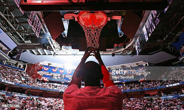 Patrick Patterson of the Toronto Raptors grabs the mesh on the net prior to facing the Indiana Pacers on October 28 2015 at Air Canada Centre in...