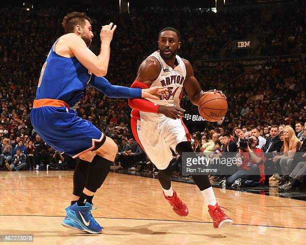 Patrick Patterson of the Toronto Raptors handles the ball against the New York Knicks on March 22 2015 at the Air Canada Centre in Toronto Ontario...
