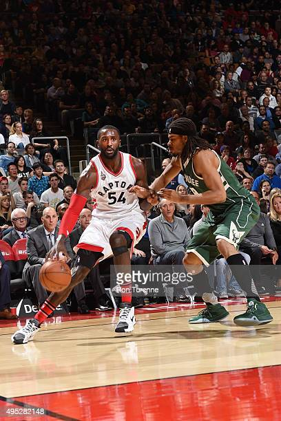 Patrick Patterson of the Toronto Raptors handles the ball against the Milwaukee Bucks during the game on November 1 2015 at the Air Canada Centre in...