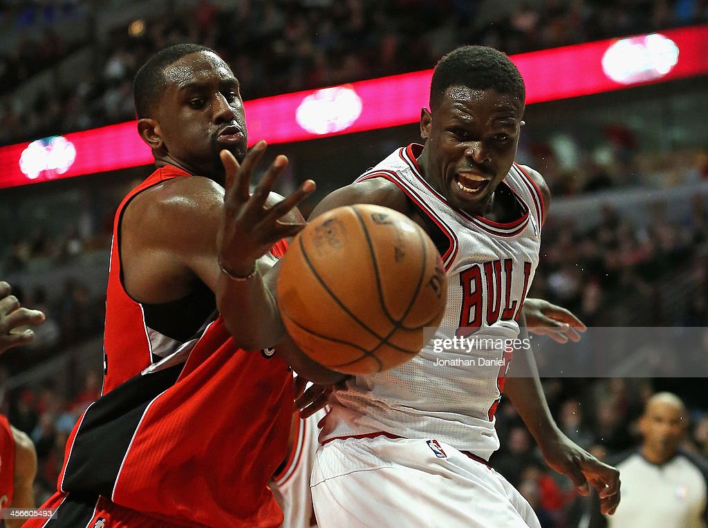 <a gi-track='captionPersonalityLinkClicked' href=/galleries/search?phrase=Patrick+Patterson&family=editorial&specificpeople=2928099 ng-click='$event.stopPropagation()'>Patrick Patterson</a> #54 of the Toronto Raptors knocks the ball away from Loul Deng #9 of the Chicago Bulls at the United Center on December 14, 2013 in Chicago, Illinois. The Raptors defeated the Bulls 99-77.