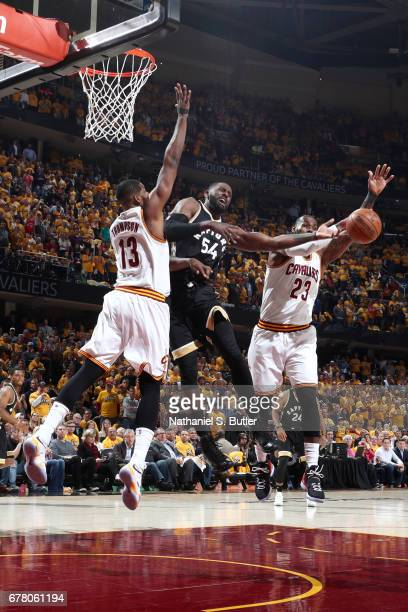 Patrick Patterson of the Toronto Raptors passes the ball against the Cleveland Cavaliers during Game Two of the Eastern Conference Semifinals of the...
