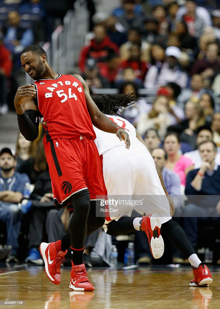 <a gi-track='captionPersonalityLinkClicked' href=/galleries/search?phrase=Patrick+Patterson&family=editorial&specificpeople=2928099 ng-click='$event.stopPropagation()'>Patrick Patterson</a> #54 of the Toronto Raptors reacts after getting fouled by <a gi-track='captionPersonalityLinkClicked' href=/galleries/search?phrase=Nene+Hilario+-+Basketball&family=editorial&specificpeople=4250456 ng-click='$event.stopPropagation()'>Nene Hilario</a> #42 of the Washington Wizards in the first half at Verizon Center on January 8, 2016 in Washington, DC.