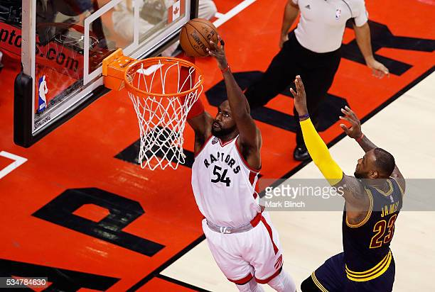 Patrick Patterson of the Toronto Raptors shoots against LeBron James of the Cleveland Cavaliers in the first half in game six of the Eastern...