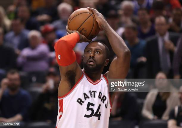 Patrick Patterson of the Toronto Raptors shoots against the Washington Wizards during NBA game action at Air Canada Centre on March 1 2017 in Toronto...
