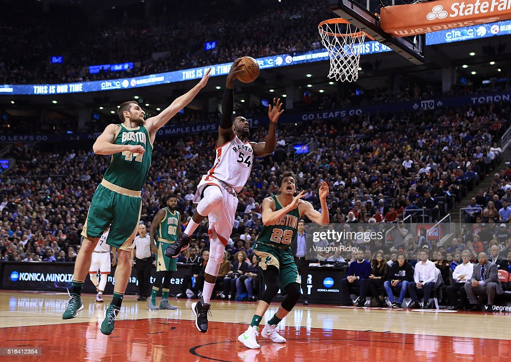 Patrick Patterson #54 of the Toronto Raptors shoots the ball as Tyler Zeller #44 of the Boston Celtics defends during the first half of an NBA game at the Air Canada Centre on March 18, 2016 in Toronto, Ontario, Canada.