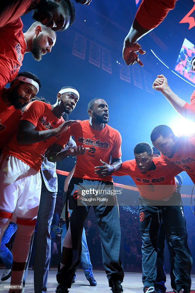 Patrick Patterson #54 of the Toronto Raptors speaks to teammates as they huddle at the start of game four of the Eastern Conference Finals against the Cleveland Cavaliers during the 2016 NBA Playoffs at the Air Canada Centre on May 23, 2016 in Toronto, Ontario, Canada.