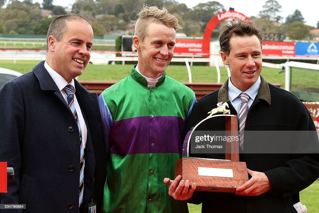 Patrick Payne (R) poses with the trophy along side Jockey Brad Mclean and Chairman Michael J Symons after Race 4, The Australian Steeplechase during Melbourne Racing at Sandown Lakeside on May 28, 2016 in Melbourne, Australia.