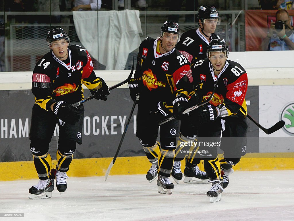 Patrick Peter, Benoit Gratton, Hugh Jessiman and Kris Foucault of the Capitals celebrate during the Champions Hockey League group stage game between Vienna Capitals and Faerjestad Karlstad on August 21, 2014 in Vienna, Austria.