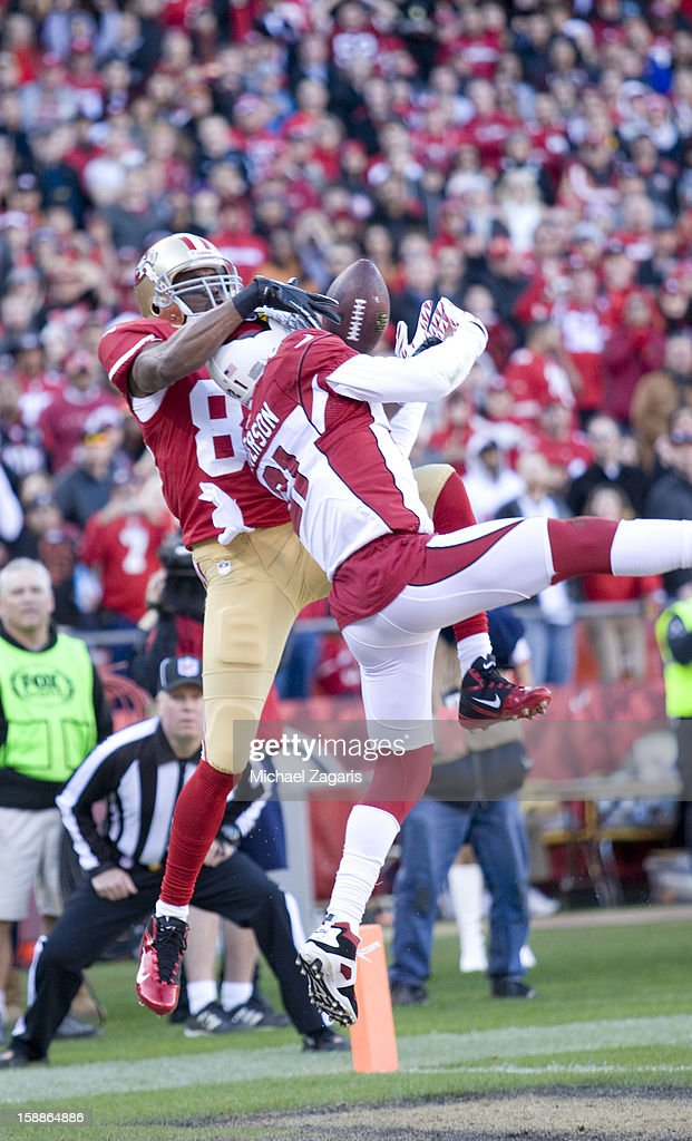 Patrick Peterson #21 of the Arizona Cardinals breaks up a pass to Randy Moss #84 of the San Francisco 49ers during the game at Candlestick Park on December 30, 2012 in San Francisco, California. The 49ers defeated the Cardinals 27-13.