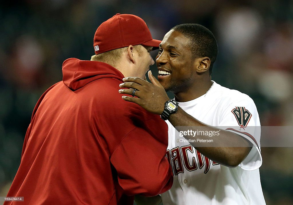 Patrick Peterson of the Arizona Cardinals greets pitcher J.J. Putz #40 before the MLB game between the Arizona Diamondbacks and Colorado Rockies at Chase Field on October 2, 2012 in Phoenix, Arizona.