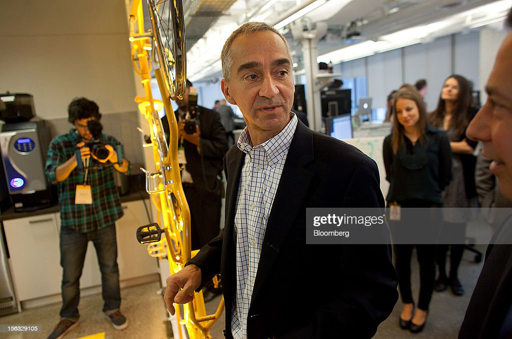 Patrick Pichette, chief financial officer of Google Inc., center, tours the new office during it's grand opening in Toronto, Ontario, Canada, on Tuesday, Nov. 13, 2012. The office space encompasses five color-coded floors and features amenities such as a pool table, video games, mini-golf putting greens and a camping lounge where employees can hold meetings in a tent. Photographer: Brett Gunlock/Bloomberg via Getty Images