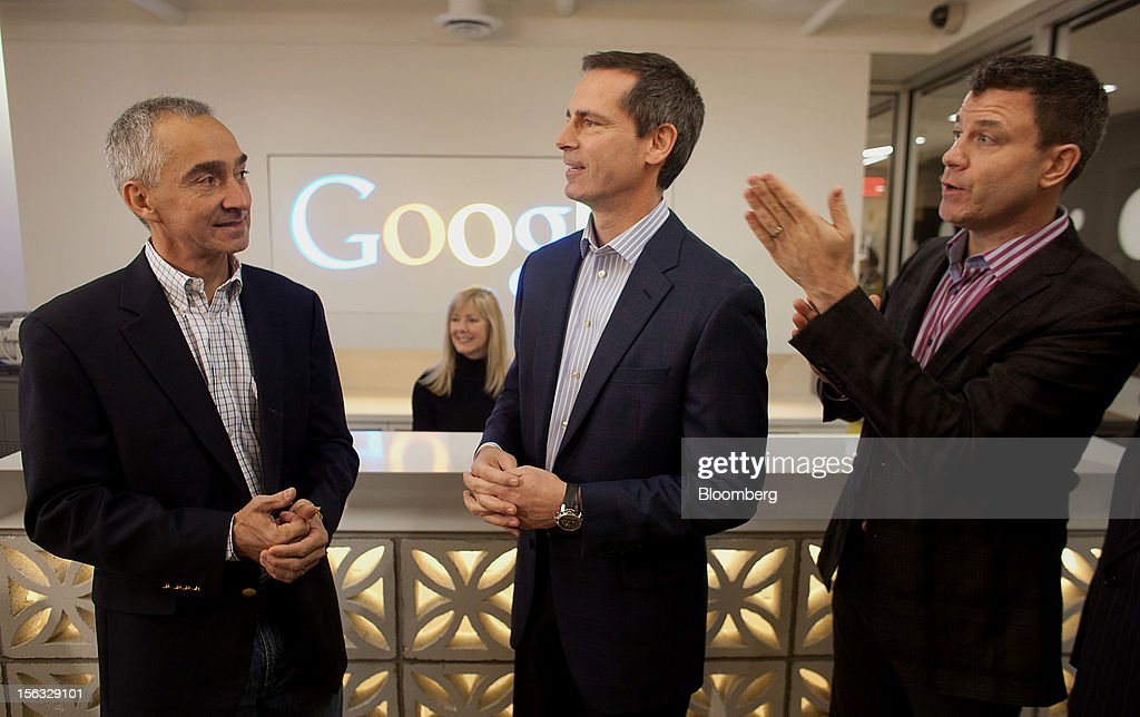 Patrick Pichette, chief financial officer of Google Inc., from left, Dalton McGuinty, Ontario's premier, and Chris O'Neil, managing director of Google Inc. Canada, chat at the front desk during a media tour for the grand opening of Google Inc.'s new office in Toronto, Ontario, Canada, on Tuesday, Nov. 13, 2012. The office space encompasses five color-coded floors and features amenities such as a pool table, video games, mini-golf putting greens and a camping lounge where employees can hold meetings in a tent. Photographer: Brett Gunlock/Bloomberg via Getty Images