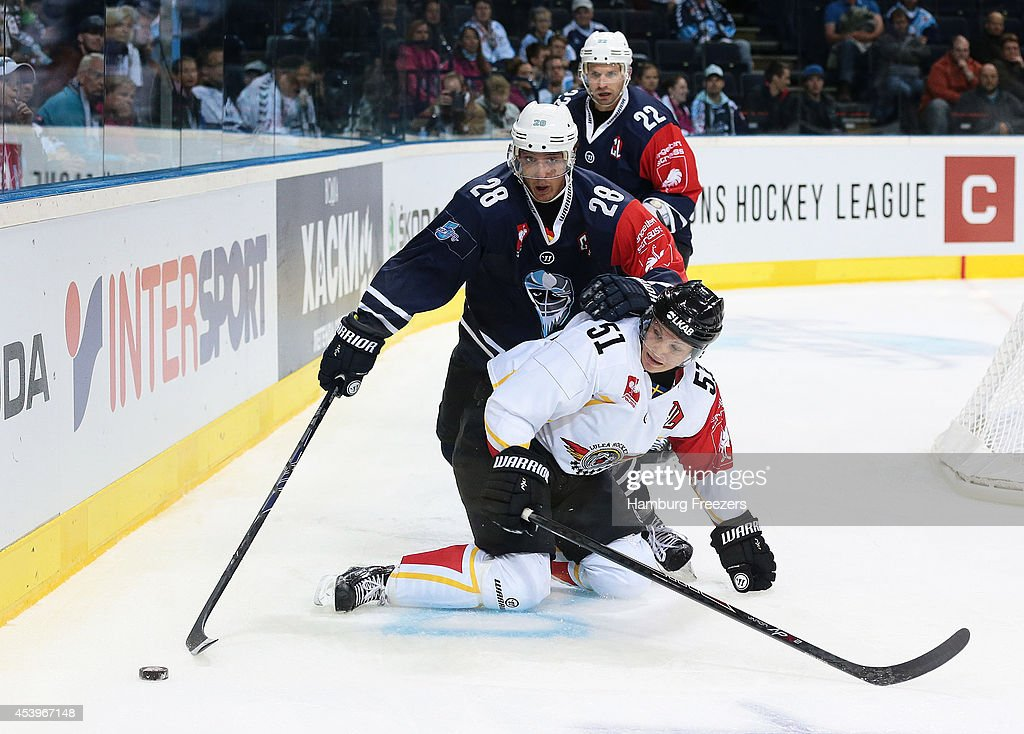 Patrick Pohl #28 of Hamburg Freezers fights with Kristian Naekyvae #51 of Lulea during the Champions Hockey League group stage game between Hamburg Freezers and Lulea Hockey on August 22, 2014 in Hamburg, Germany.