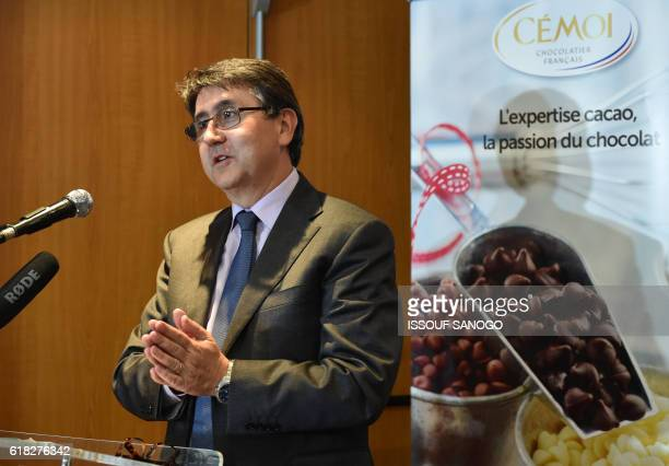 Patrick Poirrier CEO of French chocolatier Cemoi speaks as he presents on October 25 in Abidjan a new food creations using cocoa from Ivory Coast the...