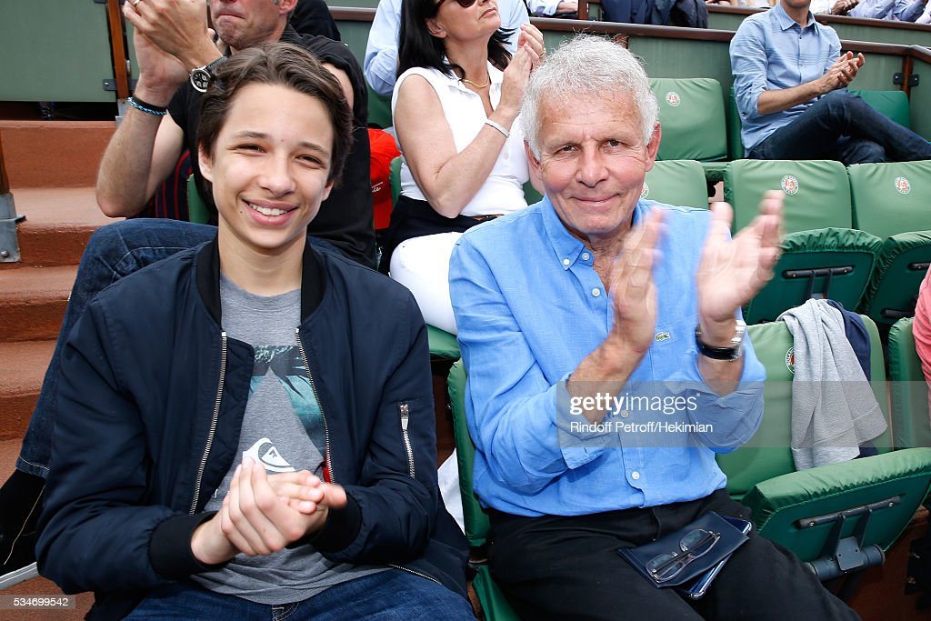 Patrick Poivre d'Arvor and his grandson Jeremy attend the 2016 French Tennis Open - Day Six at Roland Garros on May 27, 2016 in Paris, France.