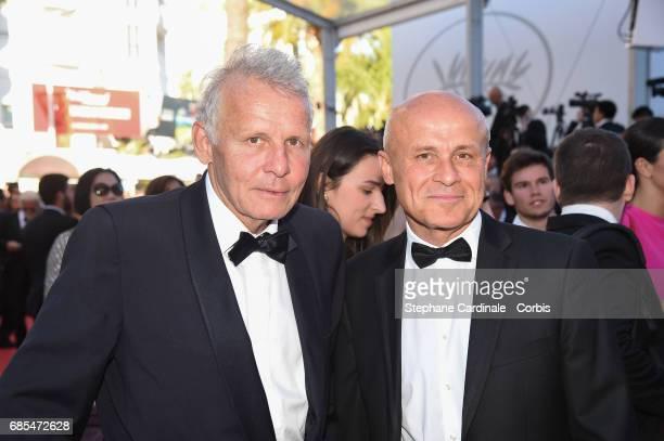 Patrick Poivre d'Arvor and Olivier Poivre d'Arvor attend the 'Okja' premiere during the 70th annual Cannes Film Festival at Palais des Festivals on...