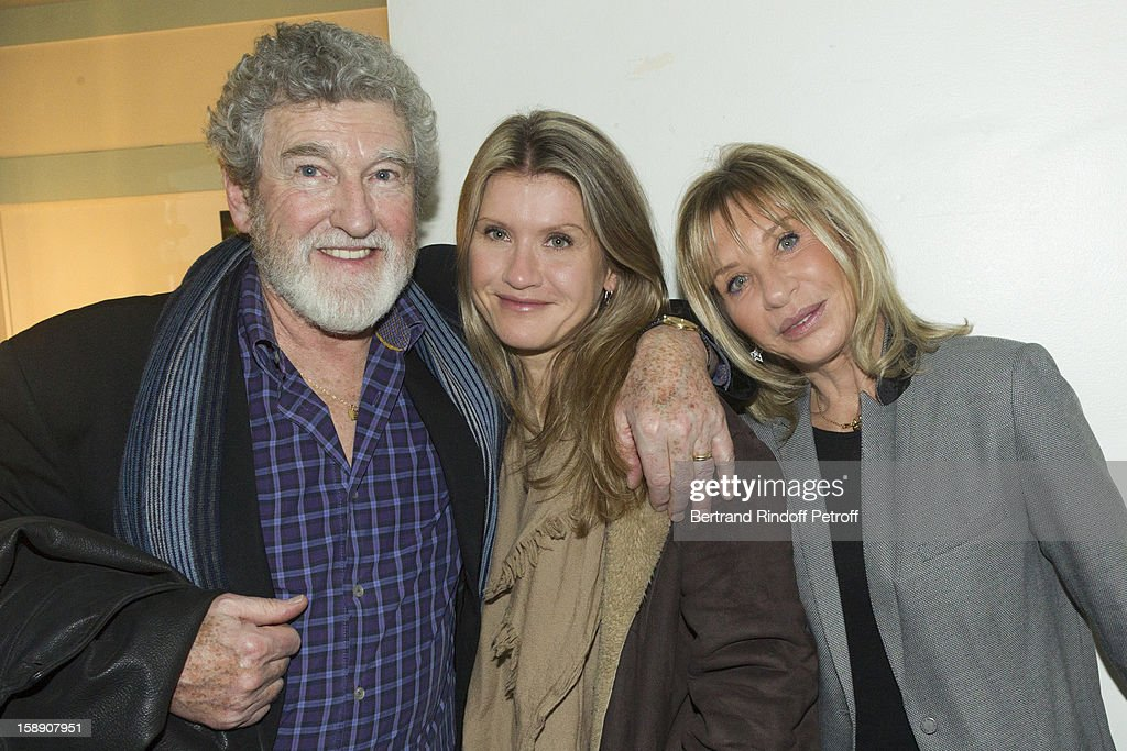 Patrick Prejean, his daughter Laura and his wife Viviane pose in French impersonator Laurent Gerra's dressing room following Gerra's one man show at Olympia hall on December 26, 2012 in Paris, France.
