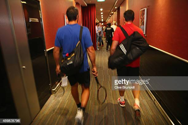 Patrick Rafter and Coach Joshua Eagle of the Singapore Slammers walk to the locker room to get ready for their match against the Manila Mavericks...