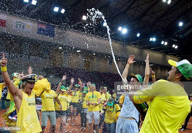 Patrick Rafter Captain of Australia celebrates his team's victory during the Davis Cup match between Poland and Australia at the Torwar Hall on...