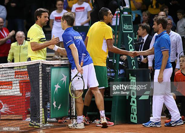 Patrick Rafter captain of Australia Richard Gasquet of France Nick Kyrgios of Australia and Arnaud Clement captain of France shake hands during the...