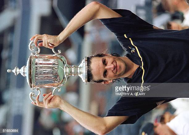 Patrick Rafter of Australia holds the US Open trophy after his victory over Greg Rusedski of Great Britain 07 Septemberin their men's final US Open...