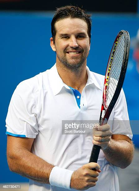 Patrick Rafter of Australia looks on in his first round doubles match with Lleyton Hewitt of Australia against Eric Butorac of the United States and...