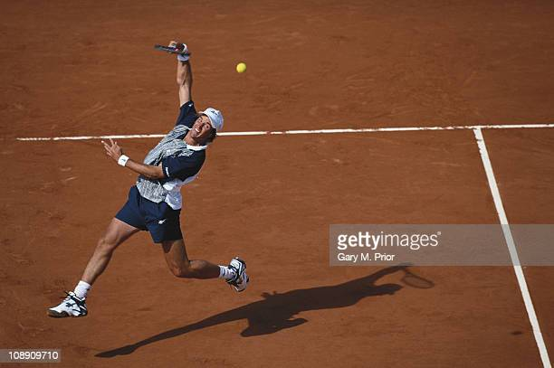 Patrick Rafter of Australia makes an off the ground overhead shot return against Sergi Bruguera during the Men's Singles semi final match during the...